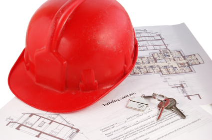 Keys and helmet on building contract